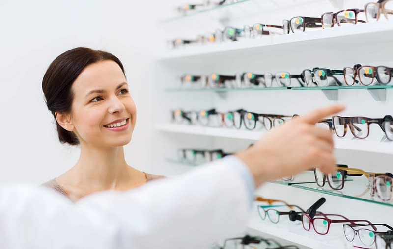 myopia nearsightedness woman picking out glasses optical