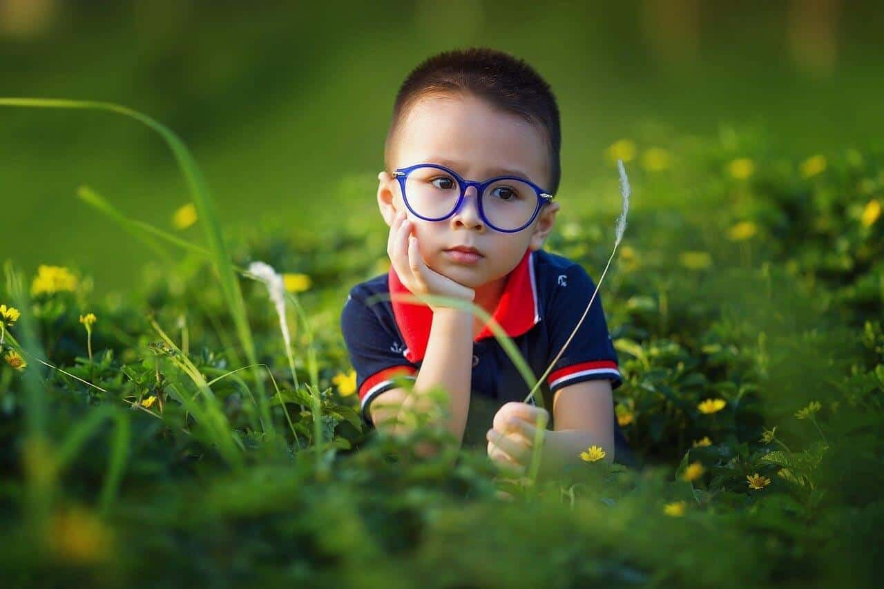 myopia control glasses contact lenses child with glasses in field