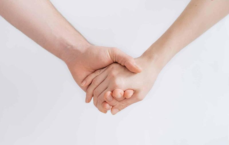 rheumatoid arthritis eye health people holding hands