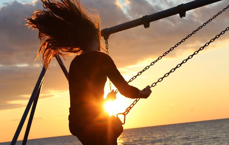 kids contact lenses child swinging at sundown